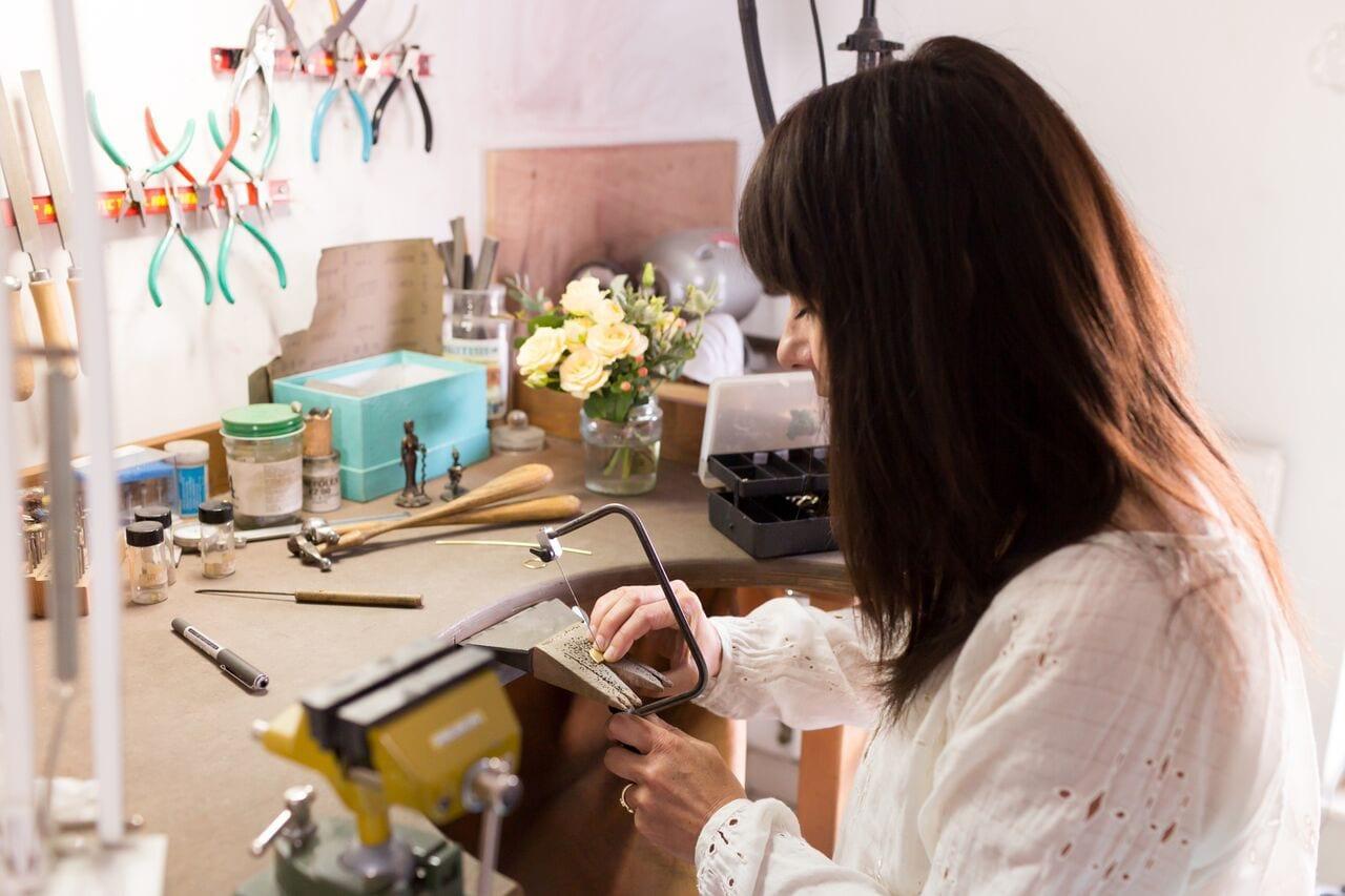 Shakti Ellenwood in her studio creating an ethical engagement ring